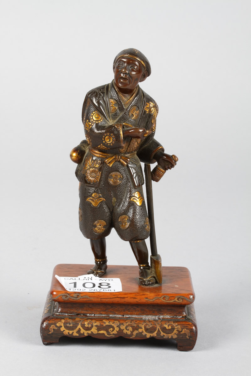 Japanese small bronze figure. Sold £620