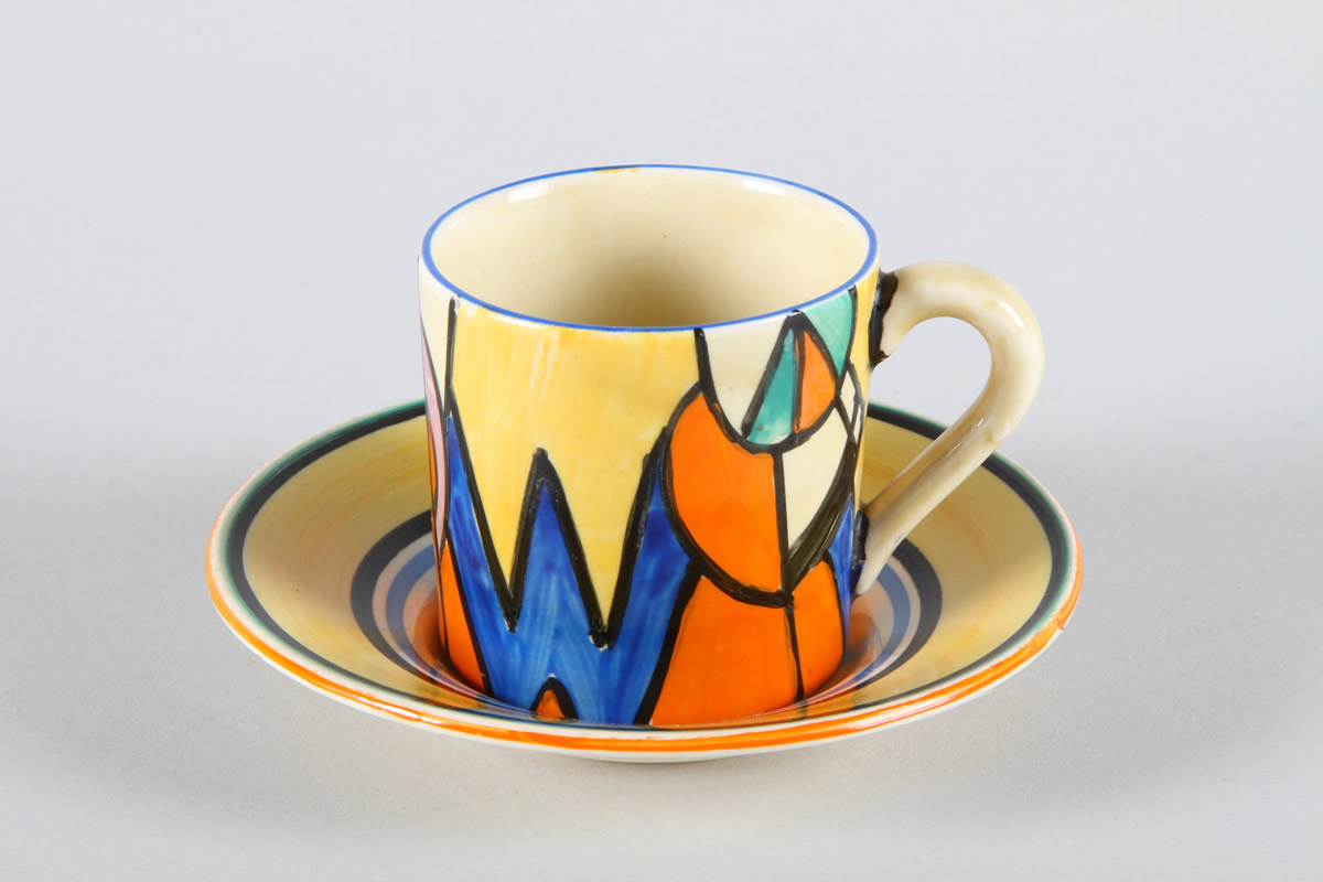 Hand Painted Newport Pottery coffee can and saucer