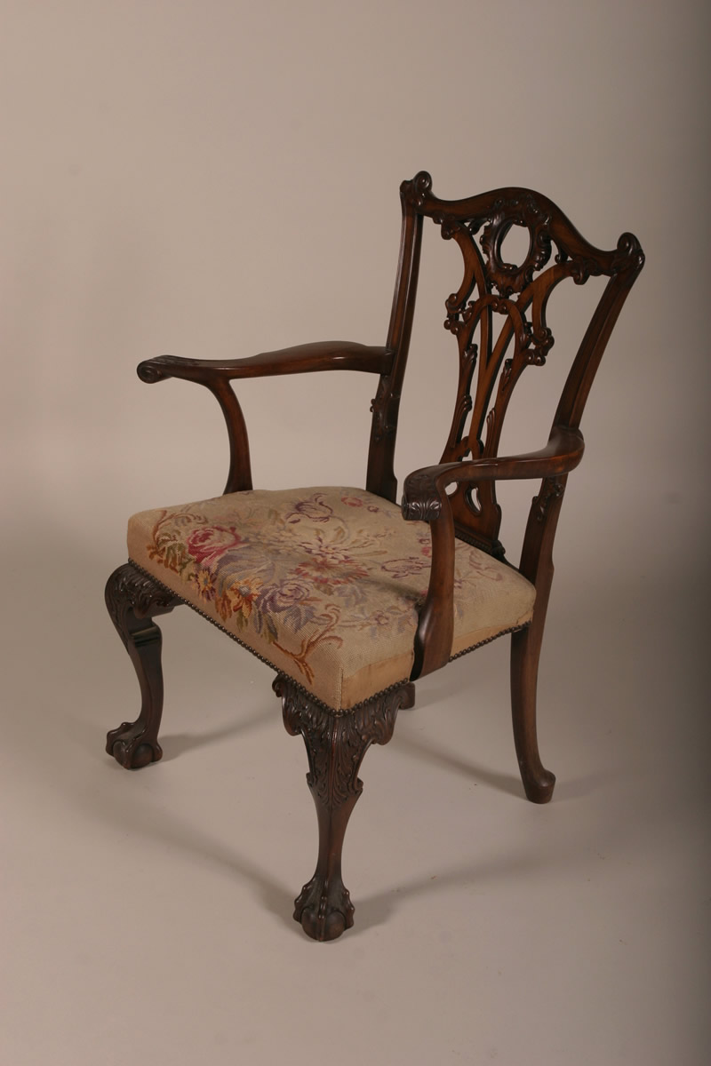 Set of 12 Chippendale style Dining Chairs, Sold £5000.jpg