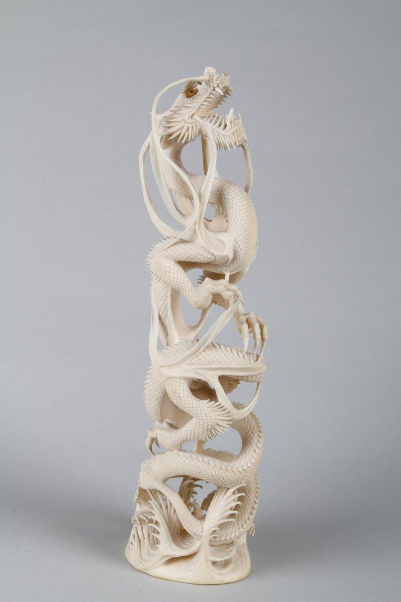 Oriental ivory carving of a dragon. Sold £1200.jpg