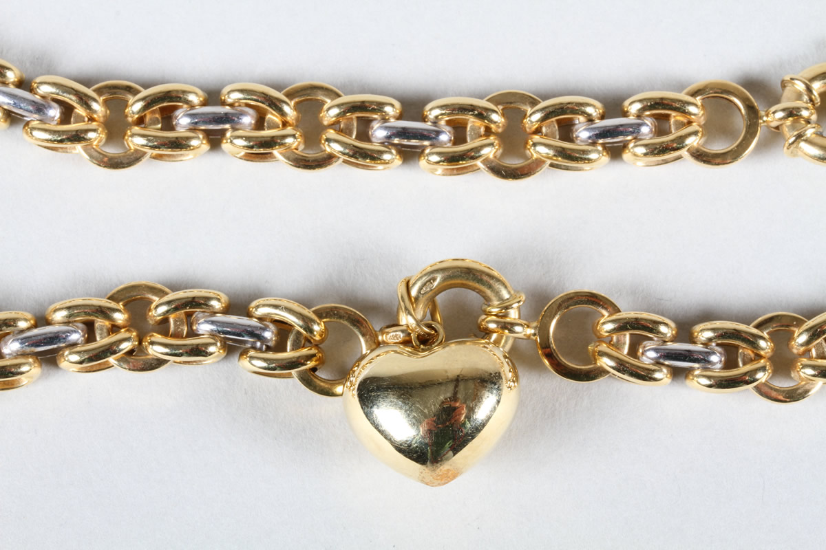 18 carat yellow and white gold necklace with heart pendant, Sold £1,000.jpg