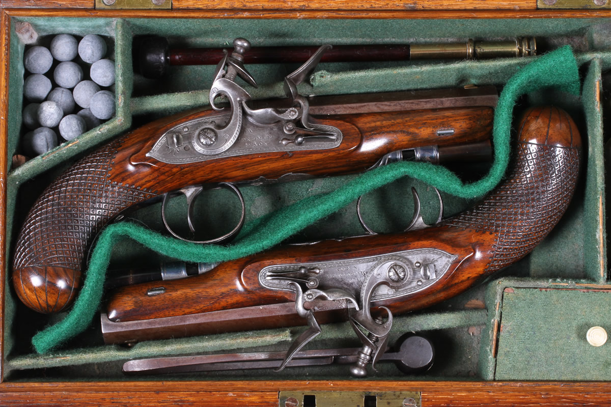 Pair of Flintlock travelling pistols,H W Mortimer. Sold £3100.jpg