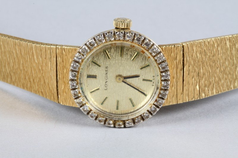 Included this week - Ladies 18 carat gold Longines Wrist Watch, gold dial with a diamond border, auction estimate £400-£600