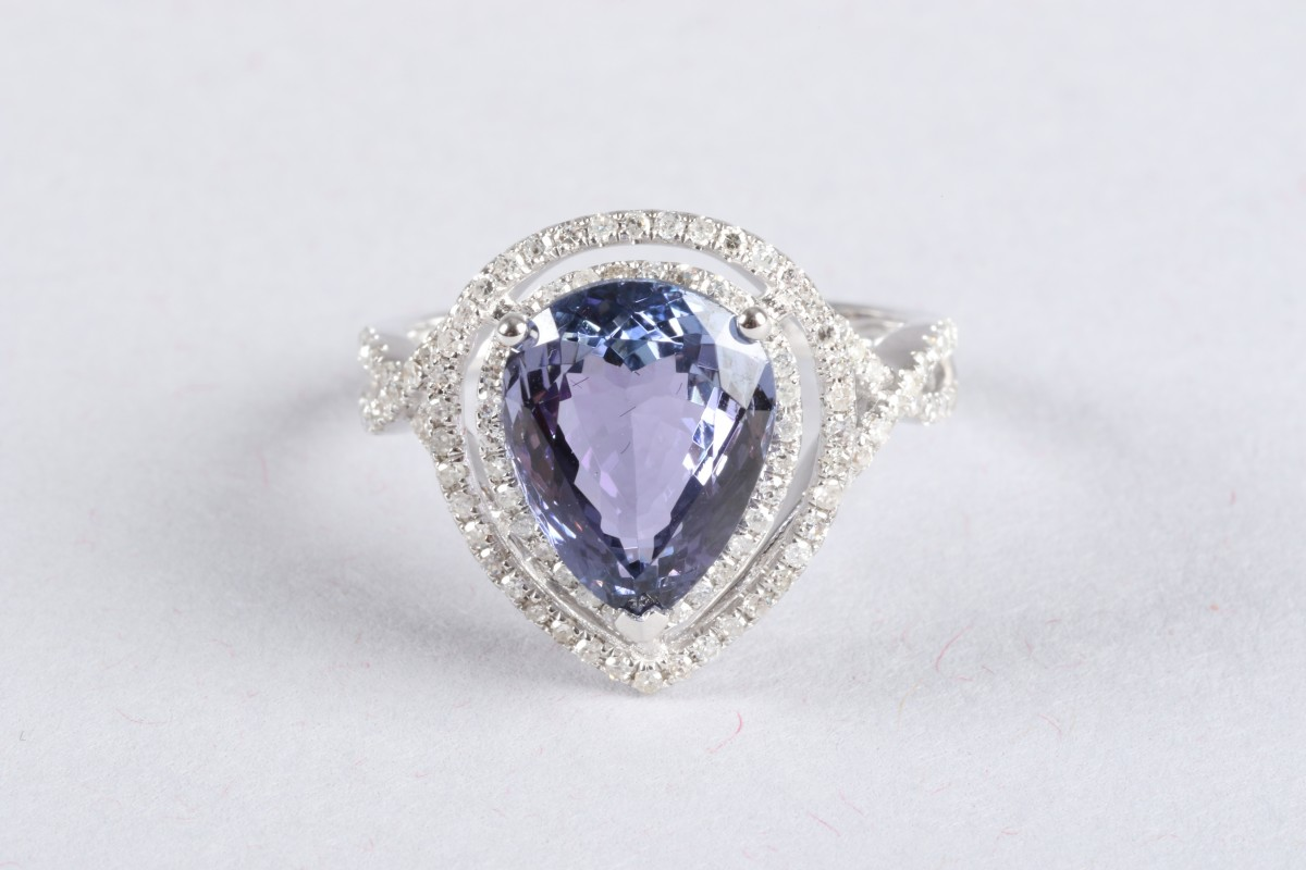 14K white gold and diamond ring set with a pear cut tanzanite. approx. 4 carats, diamond weight approx. 0.6 carats