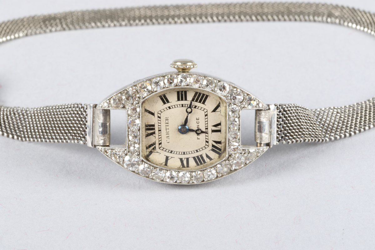 18ct gold cocktail wrist watch by Cartier, sold £2600