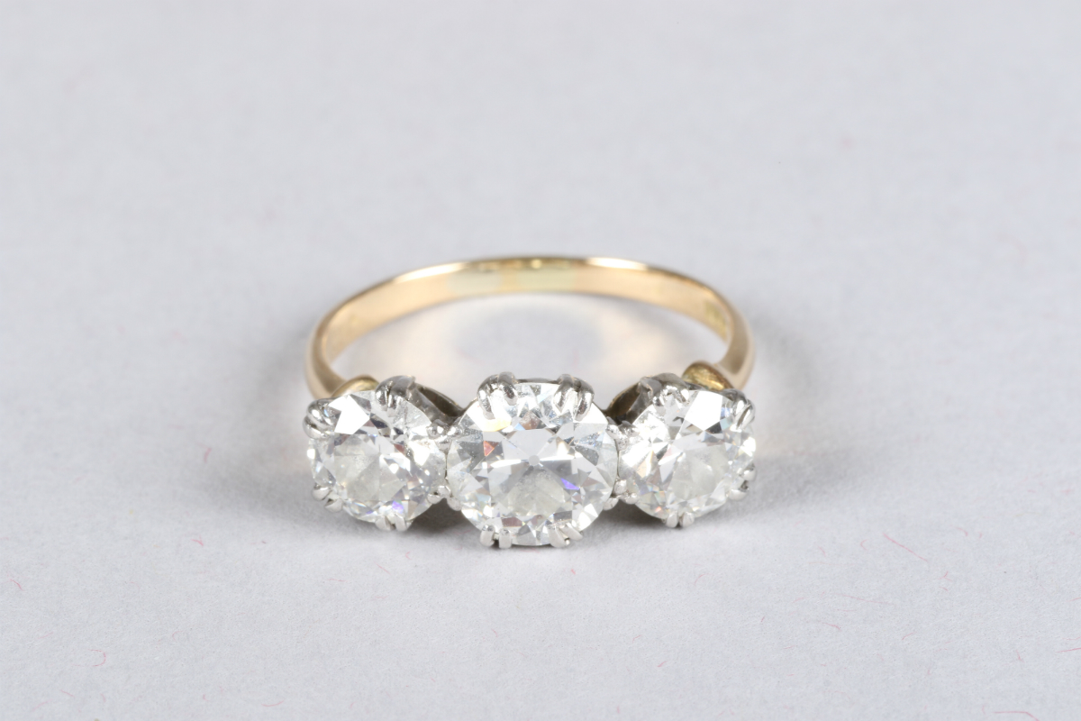 18ct gold three stone diamond ring, sold £4000