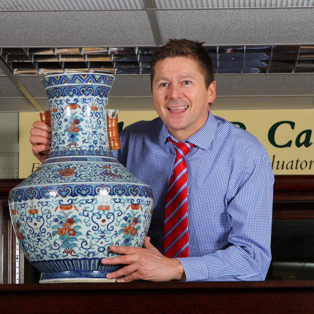 Michael Callan. Managing Director. with £10,000 vase.