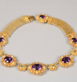Yellow metal gem set necklace, sold £1600