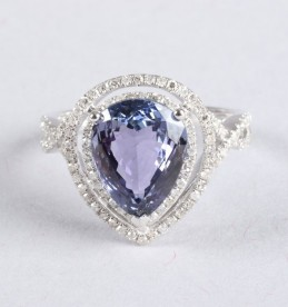14K gold and diamond ring set with a pear cut tanzanite, sold £950