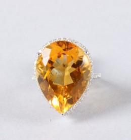 14K gold and diamond ring set with a pear shaped citrine sold £550