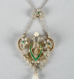 Edwardian diamond and emerald pendant. Sold for £750