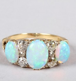 18ct gold opal and diamond ring sold £1,000