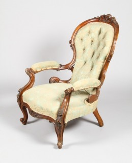Pair of walnut spoon chairs sold for £1,000