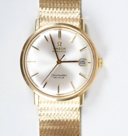 Gents 9 carat gold omega Seamaster De Ville wrist watch, Realised £1800.jpg