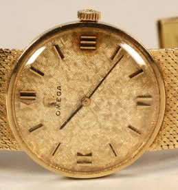 Gents Omega 9 ct gold wrist watch. Sold £720.jpg