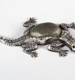 Silver pin cushion in the form of a lizard, Sold £420.jpg